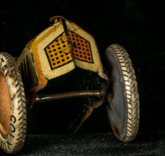 Up and Over (Light Collector) Tags: history car childhood race toy driving play antique wheels creative historical imagination excitement artifact radiator survivor hillclimb collectable racer toybox plaything axle tinplate lithographed macromondays beginswitha