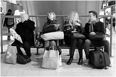 Tired, bored, amused, OMFG! (mesonparticle) Tags: street old england blackandwhite bw woman man london girl station lady train laughing bench sitting fuji yawn bored streetphotography railway waterloo tired laugh surprised fujifilm amused omg omfg yawning waterloostation x100t