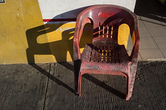 Empty Chair (FilmFlamMan) Tags: street shadow red yellow mexico yucatan coke cocacola