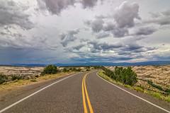 Dreamroad (RolandBrunnPhoto) Tags: road street trees sky plants mountains clouds sand nikon highway rocks desert stones pflanzen himmel wolken canyon berge steine area weite bume wste schlucht felsen expanse flche strase d7000