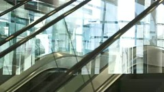 Up and down escalator with people riding (greycoastmedia) Tags: light people motion reflection glass up closeup modern mall video escalator transport shoppingcentre down center upstairs direction automatic downstairs tradecentre footage movingstaircase movingstairway stockvideo greycoastmedia