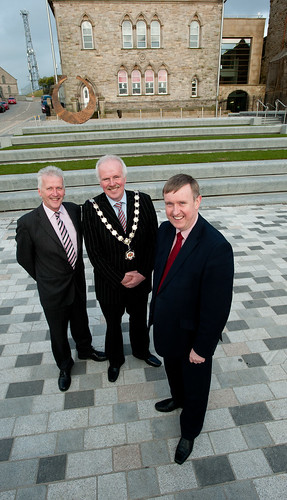 Social Development Minister Mervyn Storey, MLA is joined by (left) CEO of Dungannon and South Tyrone Borough Council, Alan Burke and the Borough's Mayor, Roger Burton as he welcomes the completion of £2.3million public realm scheme in Dungannon