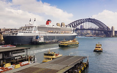 Queen Mary 2 in Sydney Harbour (Kokkai Ng) Tags: travel blue cloud tourism water horizontal ferry bay day ship harbour small sydney large australia circularquay transportation cruiseship newsouthwales medium publictransport vacations queenmary2 contrasts sydneyharbour sydneyharbourbridge manlyferry sydneyferry moored sydneyaustralia traveldestinations famousplace cunardline mediumsize overseaspassengerterminal passengercraft namedcruiseship namedcunardlineship
