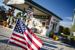 Gay Parita Sinclair Station (Notley) Tags: outdoor architecture building gasstation sign signs gayparitasinclairstation sinclairstation station petrolstation gas petrol 2010 october route66 missouri httpwwwnotleyhawkinscom notleyhawkinsphotography notley notleyhawkins 10thavenue evertonmissouri halltownmissouri flag americanflag