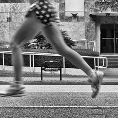 stars over midtown (weltreisender2000 (off for a while)) Tags: road atlanta blackandwhite bw motion blur sign metal race dof midtown runner airborne peachtree lettters