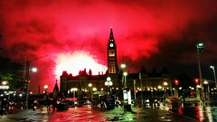 Spectacular fireworks show on Parliament Hill (walneylad) Tags: ottawa ontario canada nationalcapital parliamenthill parliamentbuildings spectacular fireworks summer august night evening cloudy rainy red white lights
