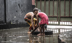 bimbi.. (Alessandro Mortola) Tags: bimbi felice felicit sorriso riflessione povert bambini allegria pioggia rain pozzanghera