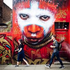 Street Art (adrianchandler.com) Tags: eastend wall peoplewalking europe england tribal red graffiti street art bricklane london
