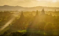 The Last Rays of Sunlight (pietkagab) Tags: bagan sunset rays sunlight light worm golden hour landscape temples myanmar pagodas burma trees hills southeastasia asia pietkagab piotrgaborek photography pentax pentaxk5ii k5 travel trip tourism adventure yellow outdoors evening ancient history buddhism buddhist