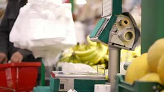 Weighing bananas in the shop. (greycoastmedia) Tags: people motion shop fruit digital video sticker banana supermarket equipment scales buy barcode customer electronic weigh weight selfservice weighing footage weighingmachine weigher stockvideo putchase greycoastmedia
