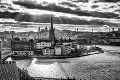 Stockholm (MacPepper) Tags: city light shadow sea vacation sky urban blackandwhite bw cloud sun sunlight white black reflection building tower texture water monochrome architecture clouds contrast island mono blackwhite nikon europe cityscape sweden stockholm gamlastan oldtown sunbeam riddarholmen d7100