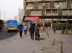 City on Display (Mink) Tags: life street city people urban bus mobile architecture walking couple tour phone centre transport pedestrians kuwait everyday zain sari fahad kuwaitcity kw madeenah  alsalem