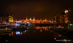 Amsterdam Central Station (JayMPix) Tags: holland building water dutch amsterdam architecture night photography lights boat canal still long exposure artistic cloudy jaympix