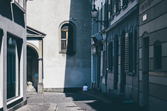 A Break in the Shade (freyavev) Tags: street streetphotography shade shadow buildings window person white shirt vsco luzern switzerland suisse schweiz