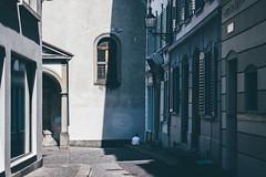 A Break in the Shade (freyavev) Tags: street streetphotography shade shadow buildings window person white shirt vsco luzern switzerland suisse schweiz