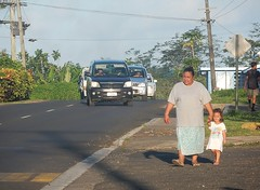 Woman Walking With Child (mikecogh) Tags: apia samoa overweight woman child pedestrians traffic road daggy relaxed