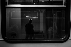 One late evening in a subway car / there is company in loneliness (zgr Grgey) Tags: 2016 50mm bw d750 nikon topkap alone frame reflection street subway window istanbul turkey