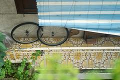 (kuuan) Tags: olympusfzuikoautotf285mm manualfocus mf olympus zuiko fzuiko 85mm f2 f285mm hcmc saigon vietnam sonya7 sony a7 balcony bicycletyres wheels