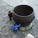 The forbidden city - Beijing. Two boys playing by the fire barrel.