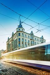 Streets of Riga (druvoart) Tags: street sky sunlight motion architecture canon tram latvia cobblestone rails polarizer polarized riga tiltshift mixedexposure samyang ts24mm 5dmkii canon5dmk2 5dmk2