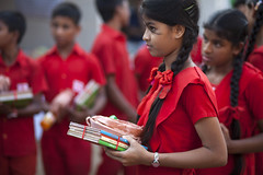 Book drive for slum kids at Ekushe Book Fair (auniket prantor) Tags: world poverty street school girls light red people girl smile asian happy hope book student education asia day dress outdoor indian south country poor fair same third editorial dhaka occasion bangladesh educate slum distribution ngo donate developing bangladeshi subcontinent majority educated distribute ekushe