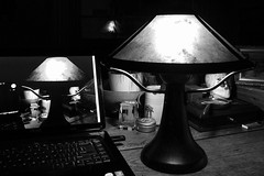 round midnight (omoo) Tags: desktop bw newyork reflection art window interiors apartment laptop westvillage kitsch dell antiques collectibles greenwichvillage roundmidnight bwphotograph 1212am missiontablelamp roundoaktable threemissiontablelamps