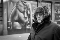 Another Elephant In The Room (Leanne Boulton) Tags: life lighting street old city uk winter light shadow portrait people urban blackandwhite bw white elephant man black cold detail male eye art texture monochrome face hat weather canon landscape photography 50mm mono scotland living blackwhite focus mural soft natural humanity bokeh outdoor expression glasgow candid streetphotography social scene human shade 7d contact society depth tone facial candidstreetphotography