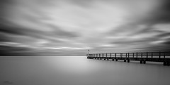 Writer on the Pier (Laws Photography | www.lawsphotography.com) Tags: longexposure blackandwhite bw seascape landscape pier movement fineart melbourne portphillipbay neutraldensityfilter nd10stop melbournelongexposure longexposurewaterbeachoceansandtimbershadowlong lawsphotography vaughanlaws