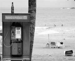 a little rest from everything (gicol) Tags: ocean street sea summer beach public beer america bottle costarica strada mare phone estate cerveza playa telefono birra spiaggia botella bottiglia