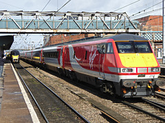 Virgin Trains East Coast Speeds Through Doncaster. (ManOfYorkshire) Tags: new red station train coast platform railway trains run east virgin service 225 doncaster 82219 91124 inaguaral
