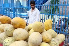 His Melons Taste of Brooding Melancholy (Mayank Austen Soofi) Tags: delhi walla boy man fruit seller his fruits taste brooding melancholy