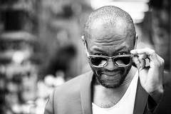 Street Portrait: Alex (Explore) (The Urban Scot) Tags: street portrait urban blackandwhite london alex monochrome sunglasses flickr fuji soho streetportrait stranger 56mm strangerportrait urbanportrait 100strangers 100strangersproject urbanscot 85mmequivalent urbanscotphotography portraitwithpermission fujixt1 july2016