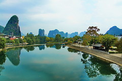 Scenic view over YuLong river from GongNong bridge (sheing.coe) Tags: yulong china sonynex5 sony mountain mountainside scenery nature naturescenes asia bridge gongnong rafting raft river yangshuo yahoo:yourpictures=scenery yahoo:yourpictures=china outdoor yahoo:yourpictures=landscape wow