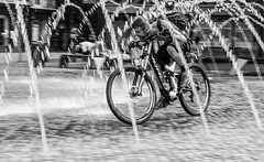 Biking in the Fountain (EightBitTony) Tags: uk england blackandwhite bw man water fountain monochrome bike bicycle canon mono blackwhite unitedkingdom yorkshire streetphotography july cycle backpack gb wakefield splash canondslr canoneos citycentre 2016 canoneos7dmarkii canon7d2 canon7dmarkii canon7dmark2 canon7dii canoneos7d2 canoneos7diicanon7dmk2