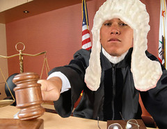 Judge using his gavel (papi_talks_funny) Tags: people person working workers workplace court courthouse courtroom trial business law legalsystem lawyer judge judgment attorney profession professional interior senior mature old older man male white caucasian knowledge balancescale elderly active decisionmaking deciding decision justice proud important job occupation distinguished handsome thinking thoughtful contemplation americanflag robe portrait face california rule ruling hitting banging hammer auction suspicious negative criminal facialexpression