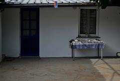 DSC_0557 (mia_alexiou) Tags: colors blue door window greece minimalist island lake ioannina geometry symmetry pegs red grey