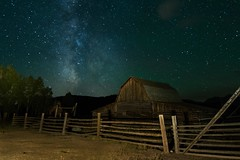 John Moulton Barn and The Milky Way (Adam's Attempt (at a good photo)) Tags: d7100 johnmoultonbarnandthemilkyway grandtetonnationalpark nationalpark nationalparks wyoming teton tetons milkyway galaxy barn fence fenced fenceposts logfence wood night nikon tokina wideangle highiso darkskies dark lightpainting lightroom lr5 mormonrow grandtetons trees stars upallnight longexposure johnmoultonbarn moultonbarn