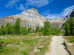 365-2-233 Not a bad spot for a bench.... (benlarhome) Tags: banff nationalpark lakelouise morainelake alberta canada mountain gebirge montagne rockies rockymountain