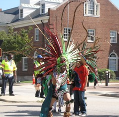 Flying Feathers (Gerry Dincher) Tags: internationalfolkfestival parade fayetteville cumberlandcounty northcarolina downtownfayetteville personstreet haystreet marketsquare mexican aztec dancers feathers headdress