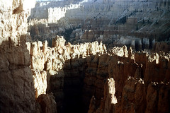 34-704 (ndpa / s. lundeen, archivist) Tags: nick dewolf nickdewolf color photographbynickdewolf 1970s 1973 film 35mm 34 reel34 utah southernutah southwesternunitedstates nationalpark brycecanyon brycecanyonnationalpark spires rock rocks rocky formation landscape terrain formations peaks outcropping outcroppings mountains erosion stratification 1972