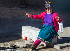 Spinning (kate willmer) Tags: woman portrait spinning clothes wool hat altiplano peru people