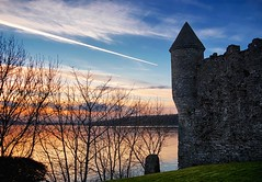 Parke's Castle (dubdream) Tags: travel ireland winter sunset sky cloud house lake tree castle water landscape contrail olympus cloudysky sligo countysligo colorimage loughgill parkescastle dubdream