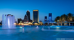 Downtown Jacksonville and Friendship Foutain, Jacksonville, Florida (DawnaMoorePhotography) Tags: lovefl dark fl florida photography tourist acostabridge afterdark atnight bluehour citylights cityskyline dawnamoorephotography dawnamoorephotographycom destination downtown dusk evening fountain friendshipfountain friendshippark image jacksonville jax lowlight night photo photograph picture riverwalk southbankriverwalk stjohnsriver stjohnsriverpark travel twilight waterfountain unitedstates us