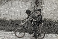 bike brothers (Pejasar) Tags: bicycle brothers siblings boys ride transportation cementblackwall street candid blackandwhite bw