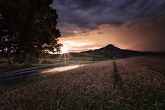 the beauty of strange weather (Suedkollektiv) Tags: stormyweather tamron canon clouds sunset flare badenwrttemberg photography bodenseelandschaft hegau afterraincomessunshine landschaft explorehegau suedkollektiv 1 landscape dariod2
