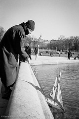 The Yacht (gwpics) Tags: france man paris french people jardinduluxembourg streetphotography 1999 toy mono playing blackwhite blackandwhite film male men monochrome person socialcomment socialdocumentary society strasenfotograpfie bw lifestyle streetpics