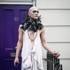 Seen at Notting Hill carnival, 2016 (oldrockerward) Tags: unusual nottinghillcarnival nottinghill london boa feather robe makeup white bald male man