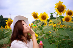 Young woman blowing bubbles in sunflower field (Apricot Cafe) Tags: asianethnicity canonef1635mmf28liiusm japan kanagawa enjoy happiness nature oneperson outdoor refresh strawhat summer sunflower traveldestinations vacation walking weekendactivities woman youngadult zamashi kanagawaken jp img647254