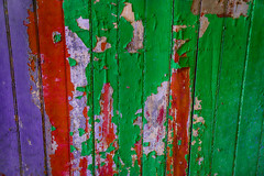 Colorful Decay (Sonia'sGallery) Tags: bysoniaa flickr flickrsoniaargenio flickrsoniasgallery green soniaargenio wood chips colors decay hardwood inside line old oldwood paint purple red wainscoting