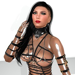 Strapped (alexandriabrangwin) Tags: alexandriabrangwin secondlife 3d cgi computer graphics virtual world mondybristol pose posing shiny glossy transparent latex catsuit straps harness buckles sheer long hair red lipstick green eyes partner wife love beautiful tattoo heart leather collar